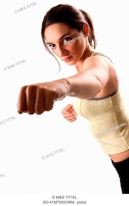 Runner punching with fist