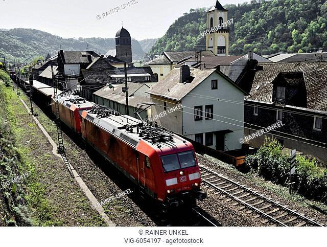 DEU , GERMANY : A cargo train of Deutsche Bahn AG is passing through St. Goarshausen / Sankt Goarshausen , 18.04.2018 - St
