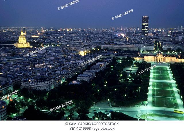 City buildings as seen from the Eiffel Tower at night including the Montparnasse Tower, Les Invalides, Champ de Mars and École Militaire, Paris, France