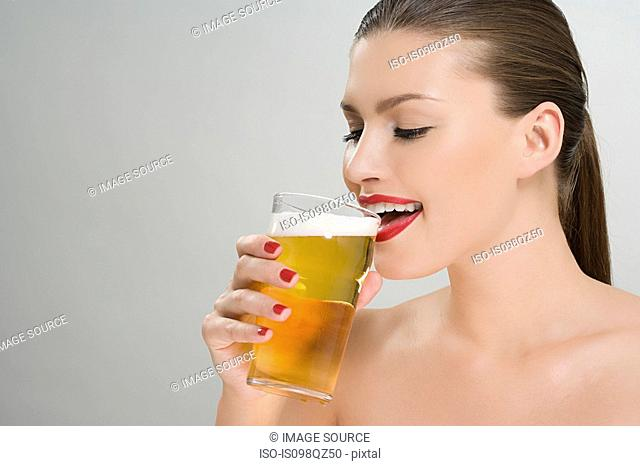 Woman drinking a pint of lager