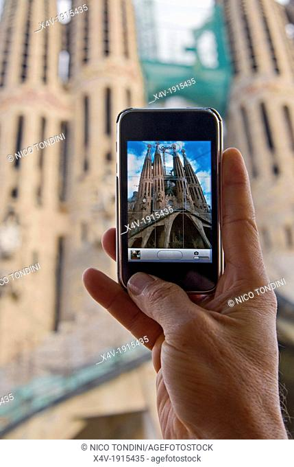 Getting picture with iPhone to Sagrada Familia Cathedral by Gaudi, Barcelona, Catalunya Catalonia Cataluna, Spain, Europe - M R