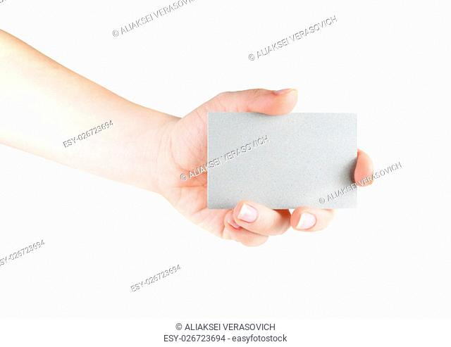 Blank business card in hand on white background. For design presentations and portfolios. Isolated on white