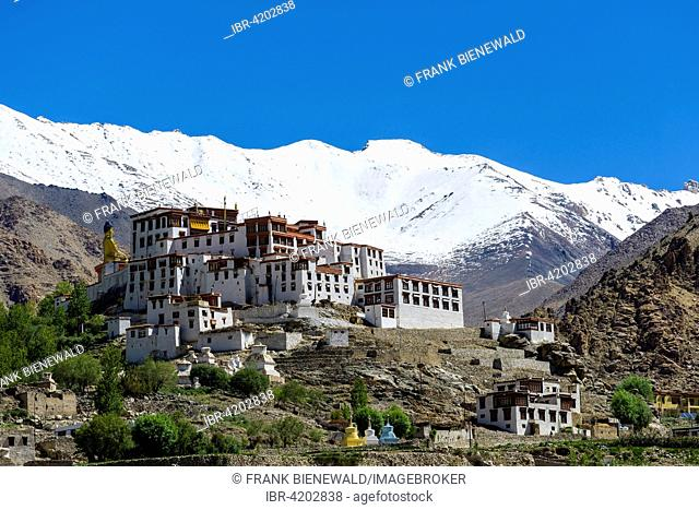 The Buildings of Likir Gompa monastery, snow covered mountains in the distance, Likir, Jammu and Kashmir, India