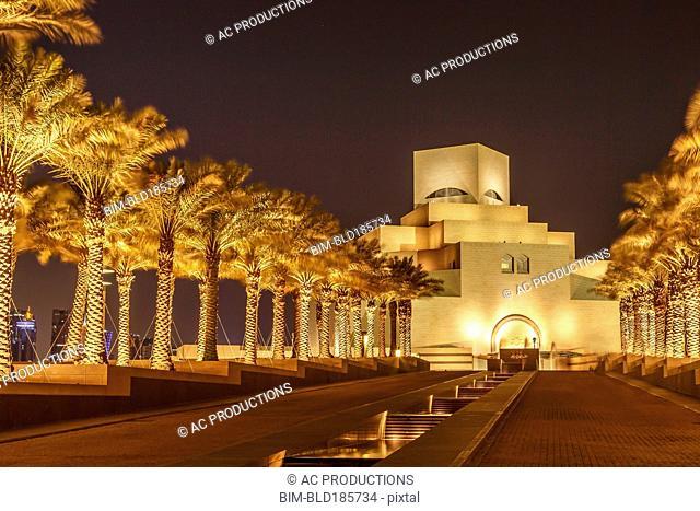 Doha Museum of Islamic Art illuminated at night, Doha, Qatar
