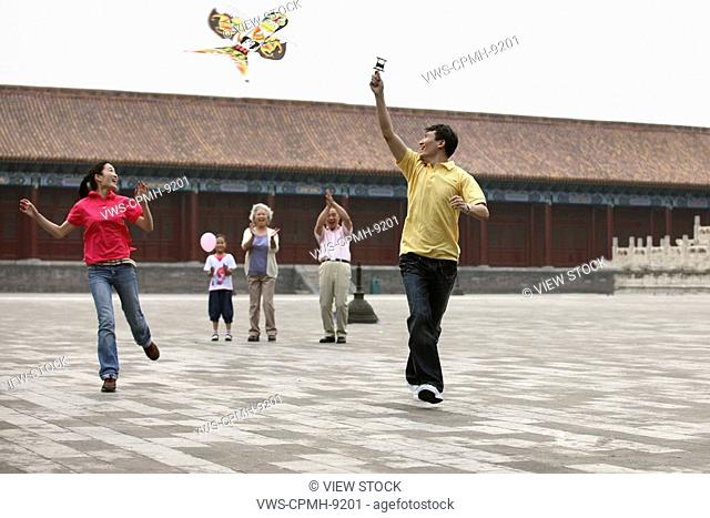 Chinese Families Flying Kites In The Forbidden City,Beijing,China