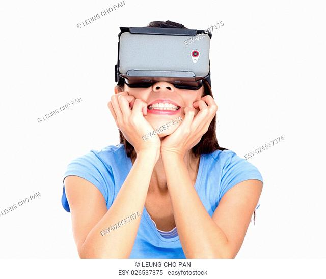 Woman looking though virtual reality device