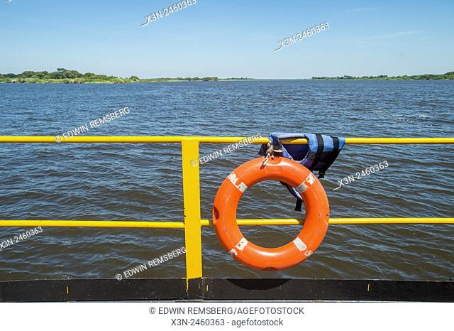 Kasane, Botswana - Life raft on railing of barge looking across river