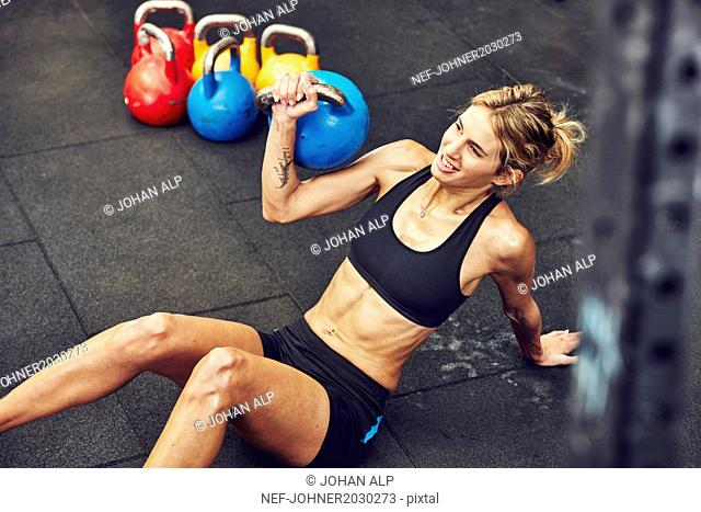 Young woman training with kettlebell