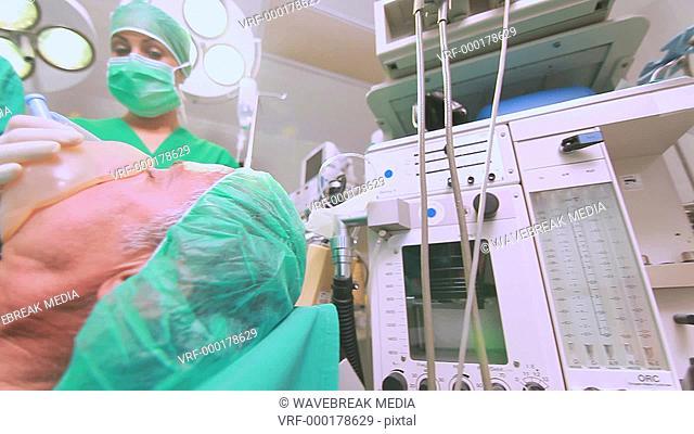 Surgeon sweating while operating