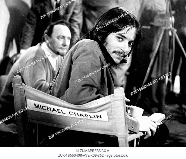 April 8, 1965 - London, England, United Kingdom - MICHAEL CHAPLIN, right, on the set of the movie, 'Promise Her Anything'