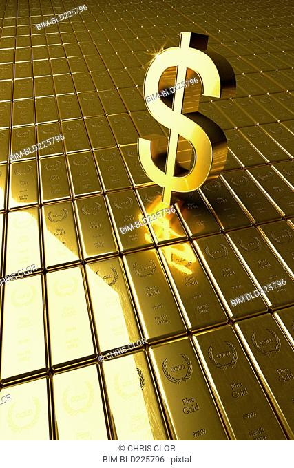 High angle view of gold bars and dollar symbol