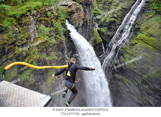 bungee jumping into a waterfall from the Gorsa Bridge in northern Norway