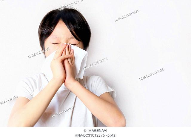 A child blowing his nose