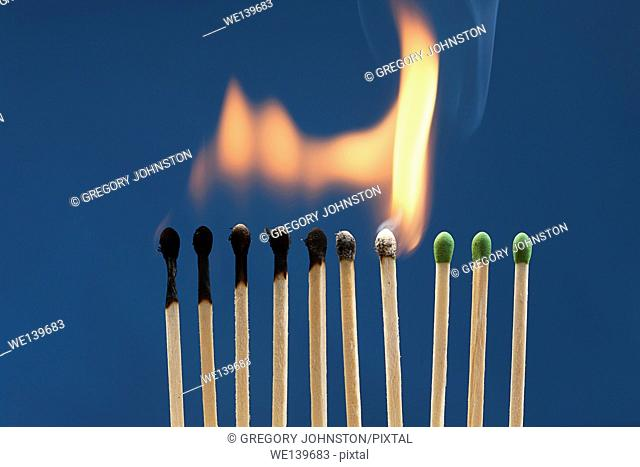 A row of match sticks had been ignited and are burning down