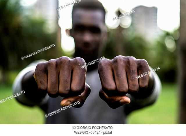 Young man showing his fists