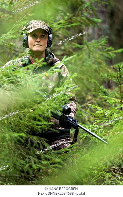 Woman hunting in forest
