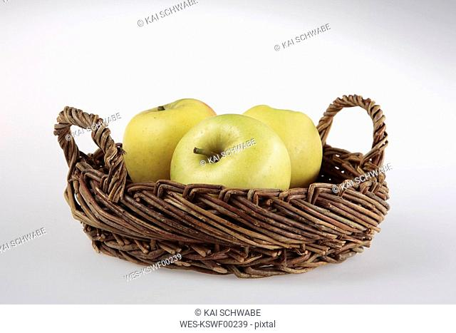 Fresh yellow apples in basket