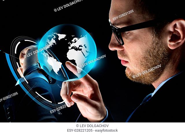 business, people, mass media and modern technology concept - close up of businessman with smartwatch and earth hologram over black background