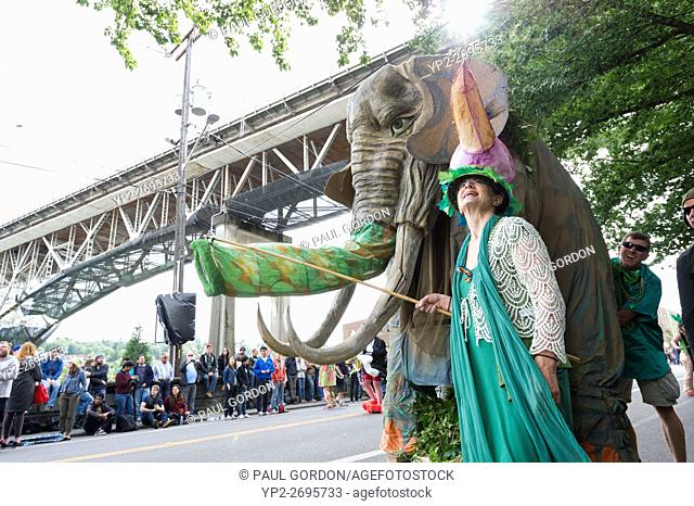 Seattle, Washington: Green Hat Ensemble collects donations to support the organization at the Summer Solstice Parade and Festival