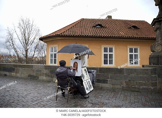Europe Prague, Czech Republic, saint charles brigde, artist painting