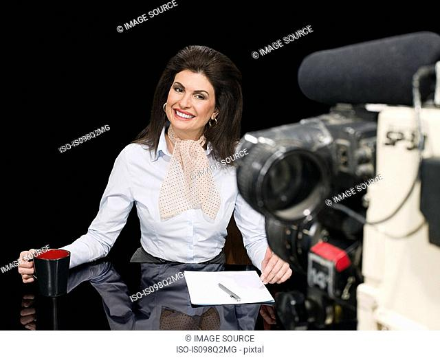 News presenter and camera