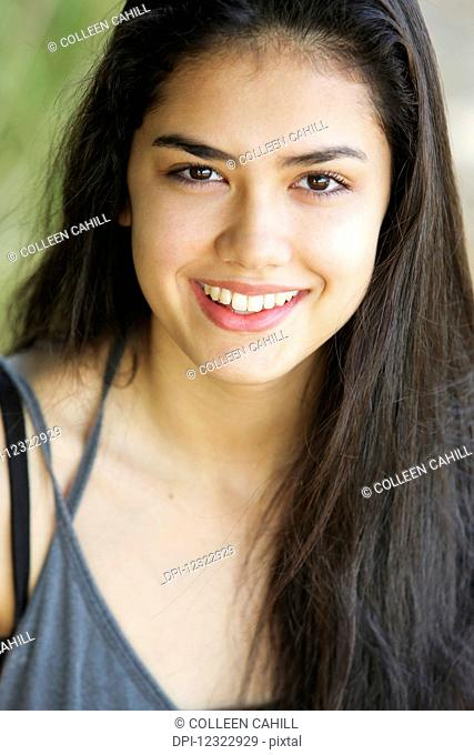 Portrait of a teenage girl with long, brown hair and brown eyes; Portland, Oregon, United States of America