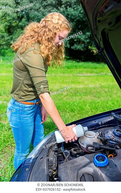 Dutch girl fills car cooling system with coolant