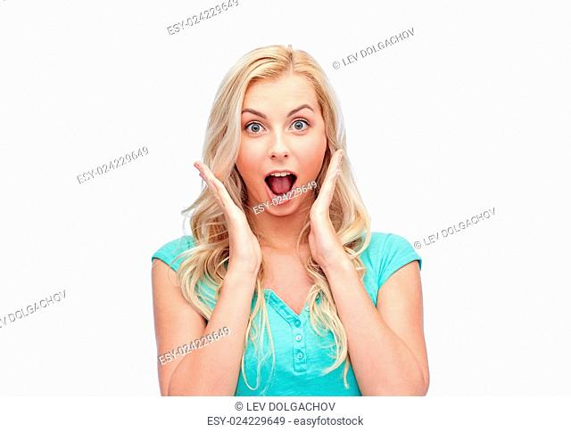 emotions, expressions and people concept - surprised smiling young woman or teenage girl