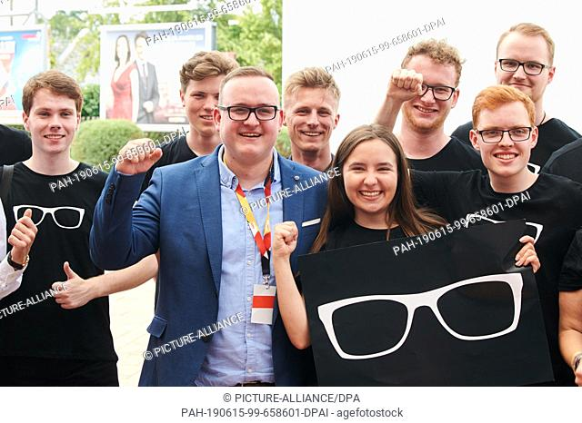 15 June 2019, Berlin: Julian Brüning (CDU), state chairman of the Junge Union, stands with his party friends in front of the Metropolishalle in Potsdam