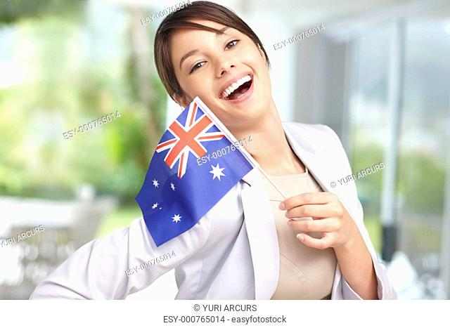 Portrait of a happy young female holding the Australian flag