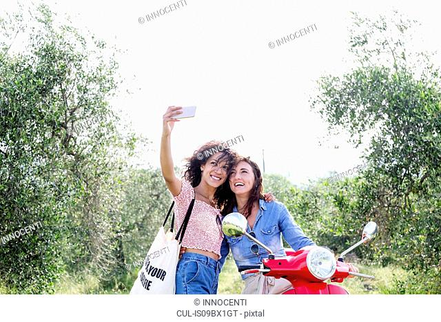 Friends taking selfie in olive grove, Città della Pieve, Umbria, Italy