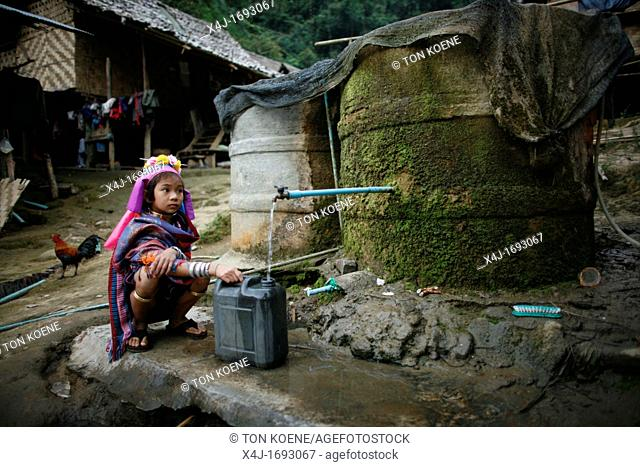 A young Longneck girl fills a jerrycan with water Approximately 300 Burmese refugees in Thailand are members of the indigenous group known as the Longnecks The...