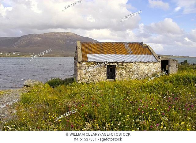 View across Achill Sound towards Corraun Hill from Achill Island, with ruined dwelling in foreground, County Mayo, Ireland