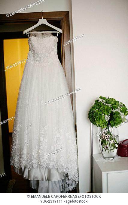 Wedding dress hanging on the door of the room