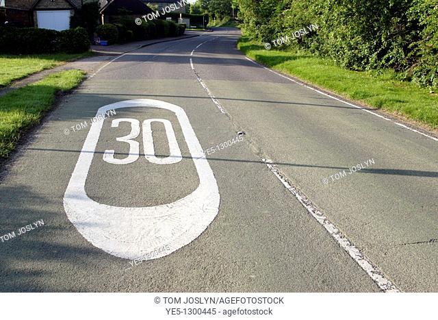 30 mph speed marking on road, Stoke Goldington, Buckinghamshire, England, UK