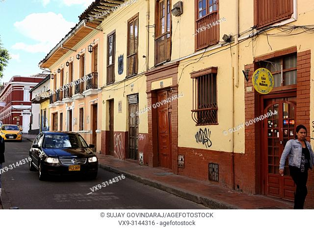 Bogotá, Colombia - May 28, 2017: Traffic drives through the old town area of La Candelaria in the Andean Capital city. Most buildings in the area go back to the...