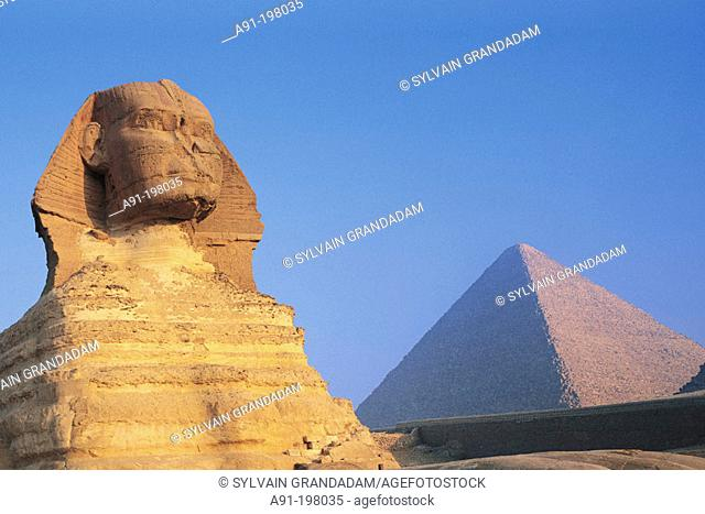 The Sphinx and Keops Pyramid at sunrise. Gizeh. Egypt