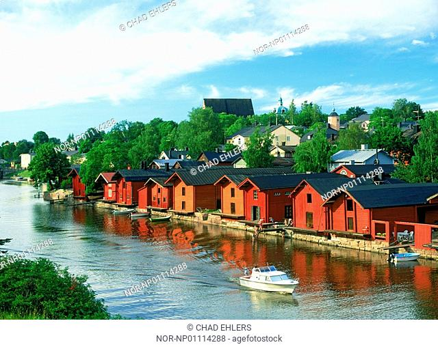 Private red hut residences on bank of Porvoo River in Finland