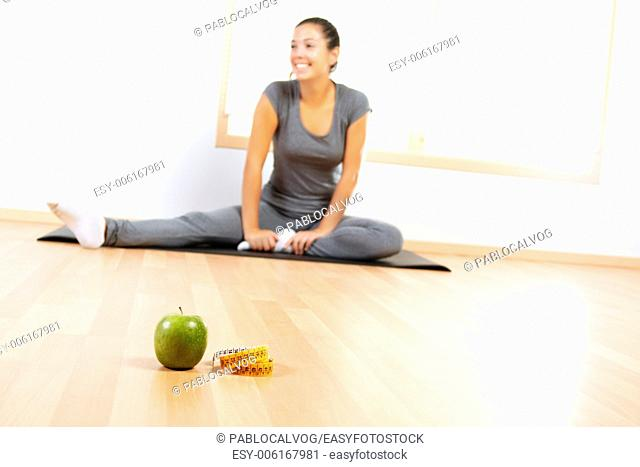 Elements of a healthy lifestyle with beautiful girl doing sport in the background