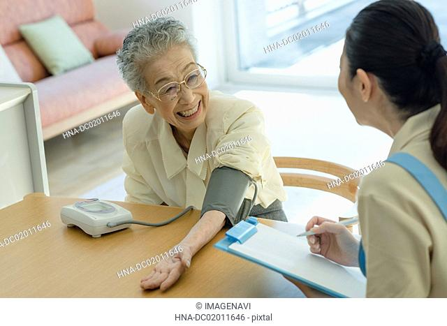 Senior woman checking blood pressure