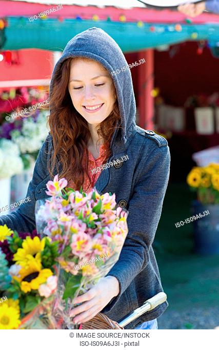 Woman buying flowers at florist