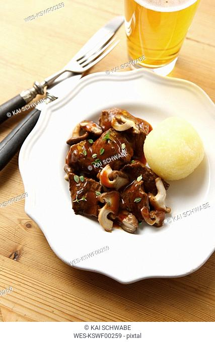 Venison goulash with mushrooms thyme and dumpling, elevated view