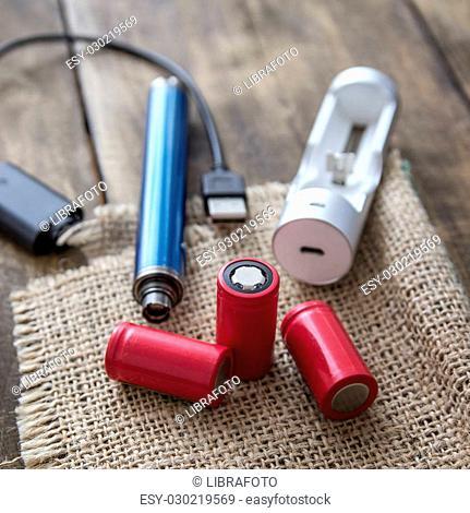 Advanced vaping device, E-cigarette equipmen on table