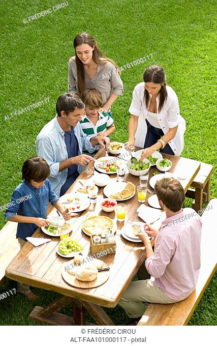 Family and friends enjoy healthy meal outdoors