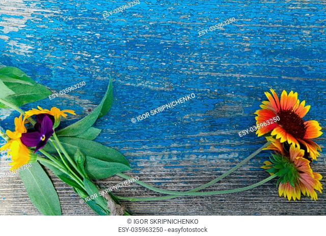 Flowers perimeter on a wooden painted board with cracks, texture, background, wallpaper