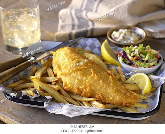 Cod in batter with French fries and salad