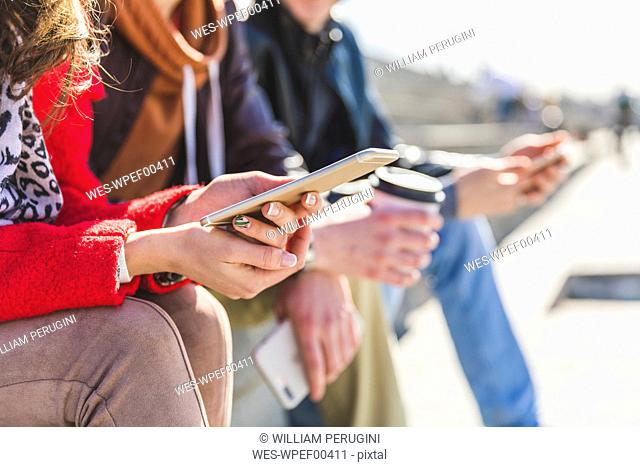 Russia, Moscow, hands holding smartphones and typing