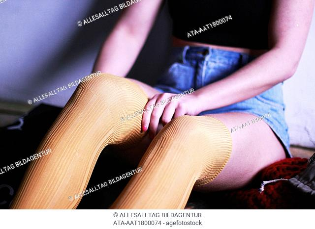 Young girl put on her overknee??s