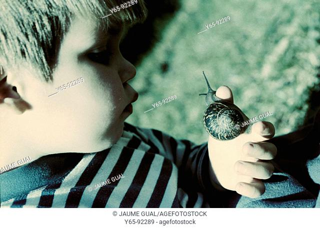 Child with snail
