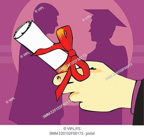 Close up view of a hand holding graduation degree